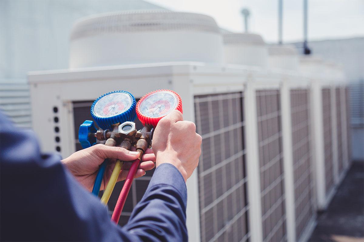 Technician check air conditioner